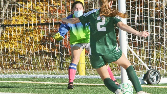 Oakmont's Jada Sibley (2) takes a shot against Narragansett goalkeeper Georgia Brewer during Wednesday afternoon's game at Arthur I. Hurd Memorial Field in Ashburnham. Sibley scored on the shot, one of two goals she had in the Spartans' 3-0 win.