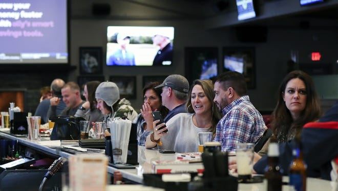 Patrons enjoy a drink at Barrett's Alehouse in West Bridgewater on Monday night, March 16, 2020, the last day for on-premises consumption due to the coronavirus. Barrett's is gearing up for outdoor dining beginning Wednesday, June 10 as part of the state's Phase 2 reopening.