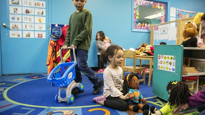 In a March 25, 2020, file photo, Camden and Brooklyn Mulvey play at the Brockton YMCA at 850 West Chestnut St., one of the emergency day care facilities in Massachusetts.