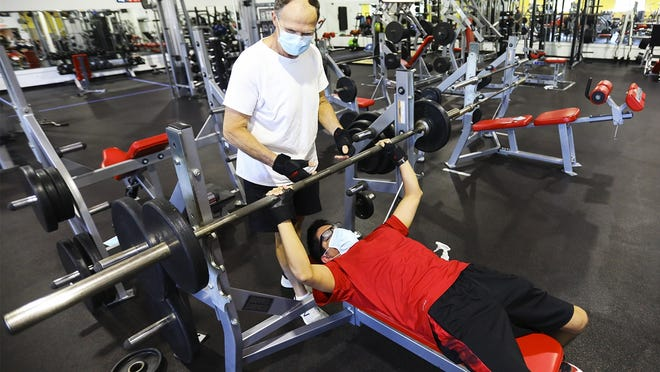 Joe Smith of Halifax spots his son Daniel Smith, 22, as they lift weights at the Old Colony YMCA in East Bridgewater on Monday, July 6, 2020. Father and son are excited to be back to the gym where they have a multitude of weights at their disposal.