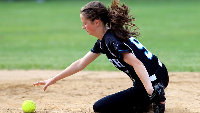 Alexis Muratore dives for the ball at second base. Muratore was part of two Patriot League champion softball teams while at Plymouth South.