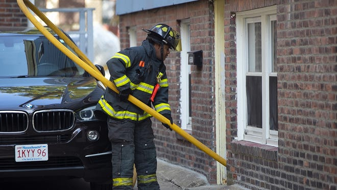 Brockton firefighters operate a fire at 8 White Avenue that appears to have originated in the basement of the multi-family home on Thursday, Sept. 24, 2020.