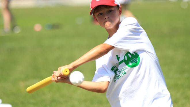 Nick Bodner, of Hingham, swings during the second annual Summer Wiffle Ball Classic to benefit Boston Children´s Hospital on Aug. 26, 2018, in Hingham.
