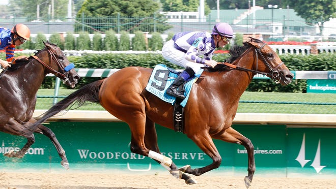Southern Honey comes on strong after an early punishing pace to triumph in the Winning Colors at Churchill Downs on Monday.