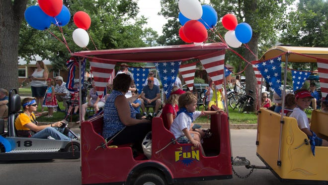 Patriotic displays and participants in the Fourth of July parade make their way down Mountain Avenue Monday, July 4, 2016.