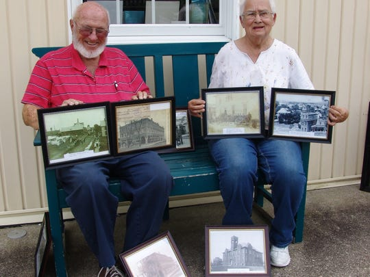Dan and June Markley pose with some of their photos that will be on exhibit at the library through August.