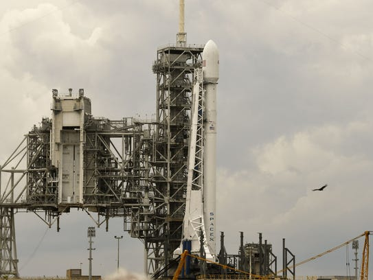 A SpaceX Falcon 9 rocket sits on pad 39A at Kennedy