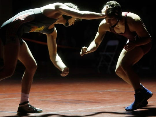 at far right La Quinta High School's Joe Garcia and Palm Desert High School's Troy Mantanona in the 160 pound boys weight class at La Quinta High School on January 10, 2018.