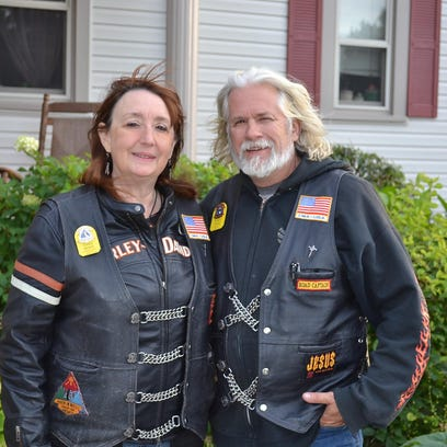 Cindi Noss, president of the Fremont chapter of the Christian Motorcyclist Association, and husband Randy Noss ride their Harleys to Christian motorcycle events all over the country.