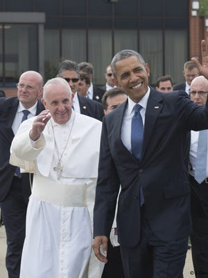 Pope Francis as he arrives with  President Barack Obama at Andrews Air Force Base in Maryland.