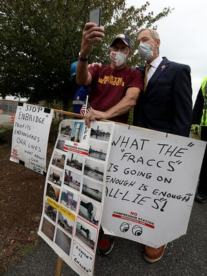 Paul Burwell of Weymouth takes a selfie with Congressman Stephen Lynch after his press conference at Kings Cove Park on Friday, Oct. 2, 2020 to discuss recent gas leaks at the Weymouth compressor station.