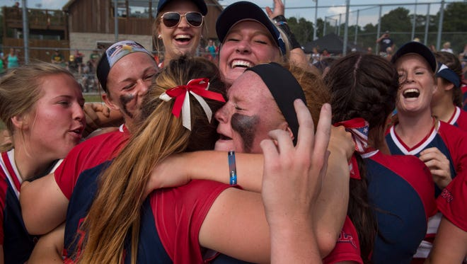 The University of Southern Indiana Screaming Eagles softball team celebrates after beating Wayne State University 5-0 and earning a berth in the NCAA Division II World Series Friday afternoon.