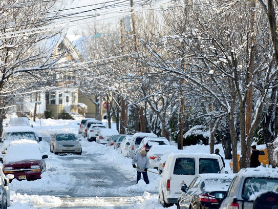 Madison Ave. in Clifton is slick with snow and black