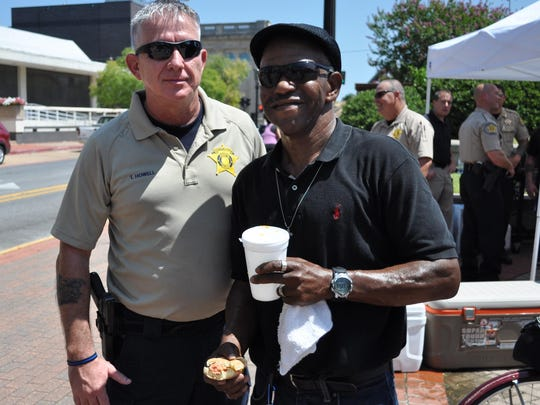 Thomas Howell (left), an RPSO deputy, poses with Reginald Major (right), a veteran who came out Saturday for a free hot dog.