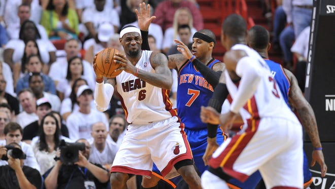LeBron James, left, and the Cavs will host Carmelo Anthony and the Knicks on Oct. 30.