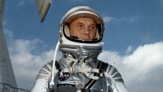 Astronaut John Glenn wears a Mercury pressure suit during training for his 1962 space flight.