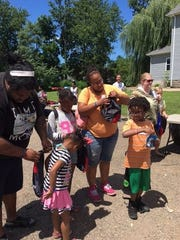Kids received free book bags and school supplies Saturday during the Unity in the Community Block Party on Bowman Street.