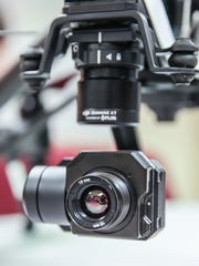 A FLIR integrated thermal camera is attached to a DJI