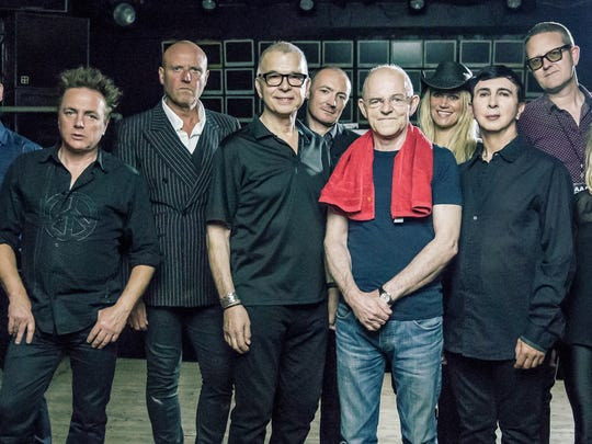 "Tony Visconti (third from left), Mick ""Woody"" Woodmansey (fifth from left) and Holy Holy perform in New Brunswick on April 6."