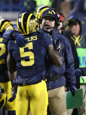 Michigan coach Jim Harbaugh and Jabrill Peppers on the sideline after a touchdown against Indiana during U-M's 20-10 win Nov. 19, 2016.