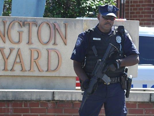outside the gate to the Washington Navy Yard on Sept. 17 in Washington ...