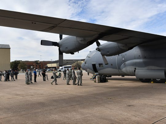 A crowd gathers around the newest addition to aircraft maintenance training at Sheppard Air Force Base, an MC-130P from the Air National Guard's 129th Rescue Wing. The trip here from Moffett Federal Airfield in California was its final flight.