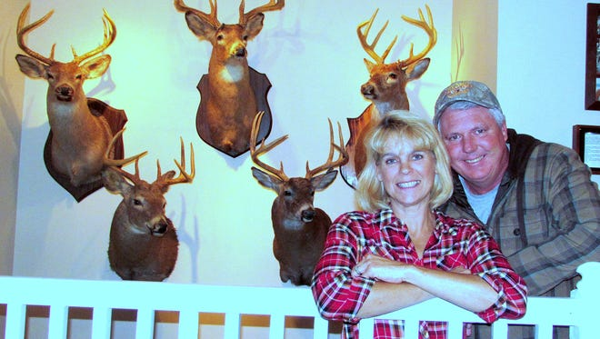 Stacy and Jonathan Evans of Horseheads show off some of their trophy bucks.