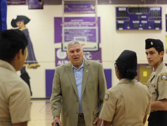 Marine Corps veteran Manuel Arismendi speaks with students in Miller High School's ROTC program. He attended a Veterans Day ceremony at the school Friday.