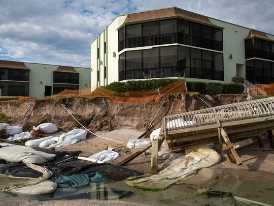 In this file photo, sand bags and other attempts to slow erosion sit scattered among damaged walkovers and eroded beach near the La Coquina condo complex on June 8, 2016, the day after Tropical Storm Colin passed Masasota Key in Charlotte County, Fla. Residents of the beach community were left scrambling to address the erosion and limited funding for beach renourishment from the state because of the lack of public access to the beach.