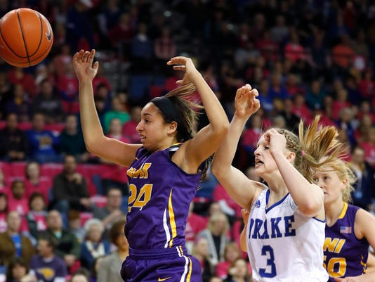 Northern Iowa guard Mikaela Morgan, left, fights for a rebound with Drake forward Lizzy Wendell (3) during the first half of an NCAA college basketball game, Friday, Feb. 24, 2017, in Des Moines, Iowa. (AP Photo/Charlie Neibergall)