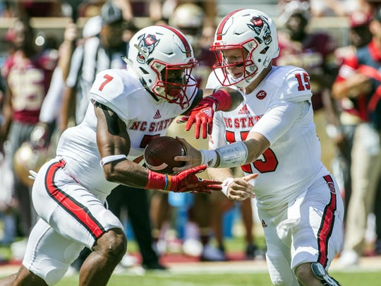 "North Carolina State running back Nyheim Hines, taking the handoff from quarterback Ryan Finley, said the Louisville game has ""been circled on a lot of people's calendars probably in the locker room."" The Cardinals beat the Wolfpack 54-13 last season."