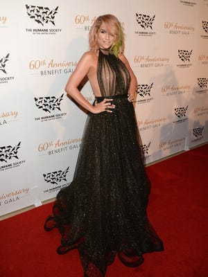 Kesha attends the Humane Society of The United States 60th anniversary gala in Beverly Hills on March 29, 2014.