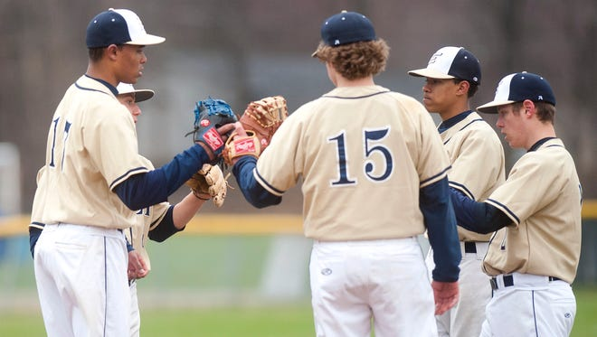The Essex infield huddles around pitcher Noah Baez, left, before the start of the fourth inning during Friday's baseball game against Rice in South Burlington.