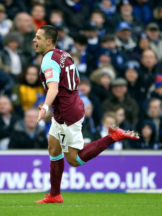 West Ham United's Javier Hernandez, celebrates scoring his side's first goal of the game, during the English Premier League soccer match between Brighton and West Ham United, at the AMEX Stadium, in Brighton, England,  Saturday, Feb. 3, 2018. (Steven Paston/PA via AP)