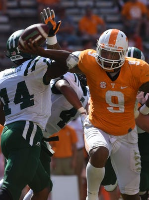 Tennessee defensive end Derek Barnett (9) pressures Ohio quarterback Greg Windham (14) during the second half at Neyland Stadium on Saturday, Sept. 17, 2016. UT won the game 28-19.
