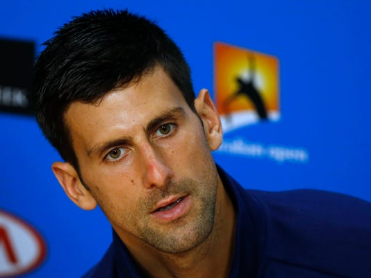 Novak Djokovic of Serbia answers questions at a press conference following his semifinal win over Roger Federer of Switzerland at the Australian Open tennis championships in Melbourne, Australia, Thursday, Jan. 28, 2016.(AP Photo/Vincent Thian)