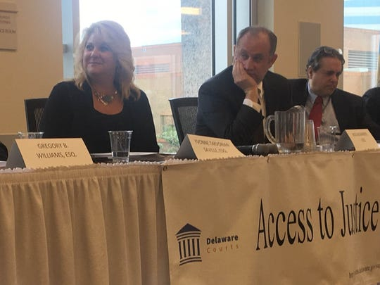 Delaware Access to Justice Commission members Yvonne Takvorian Saville, Rick Alexander and Lewis Lazarus listen to a speaker present the group's report based on two years of research into the accessibility of civil courts for poor people.