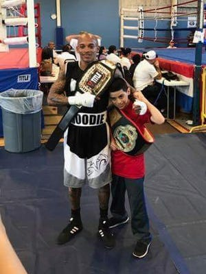 John Moodie, left, and Chris Rodriguez, both of ROUND13 Boxing in Palm Bay, won PAL state titles in Fort Pierce last weekend.
