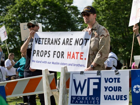 Veterans Jake Maier of Stirling, NJ and Perry O'Brien of Brooklyn protest with the Vets vs Hate campaign. Crowds gather prior to the Donald Trump rally held in Lawrence Township with Governor Chris Christie. Lawrence Township, NJ Thursday, May 19, 2016@dhoodhood