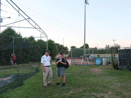 Crescent coach Gary Adams, left, and Anne Cioffi, right,