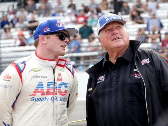 Conor Daly, who drives the No.4 ABC Supply Co. Chevrolet, stands next to racing team owner A.J. Foyt on May 20, 2017, at the Indianapolis Motor Speedway.