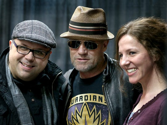"At Wizard World Comic Con Indianapolis in 2015,  actor Michael Rooker from ""The Walking Dead"" and ""Guardians of the Galaxy"" poses for a photo with fans Jason and Chaslin DeVault."