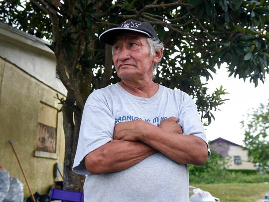 A five-year resident of Indiantown, Miguel Bidah Honorio, originally of Veracruz, Mexico, discusses his struggles and hopes for the future after incorporation Nov. 9, 2017, outside his residence on the 14000 block of Southwest Dr. Martin Luther King Jr. Drive in Indiantown.
