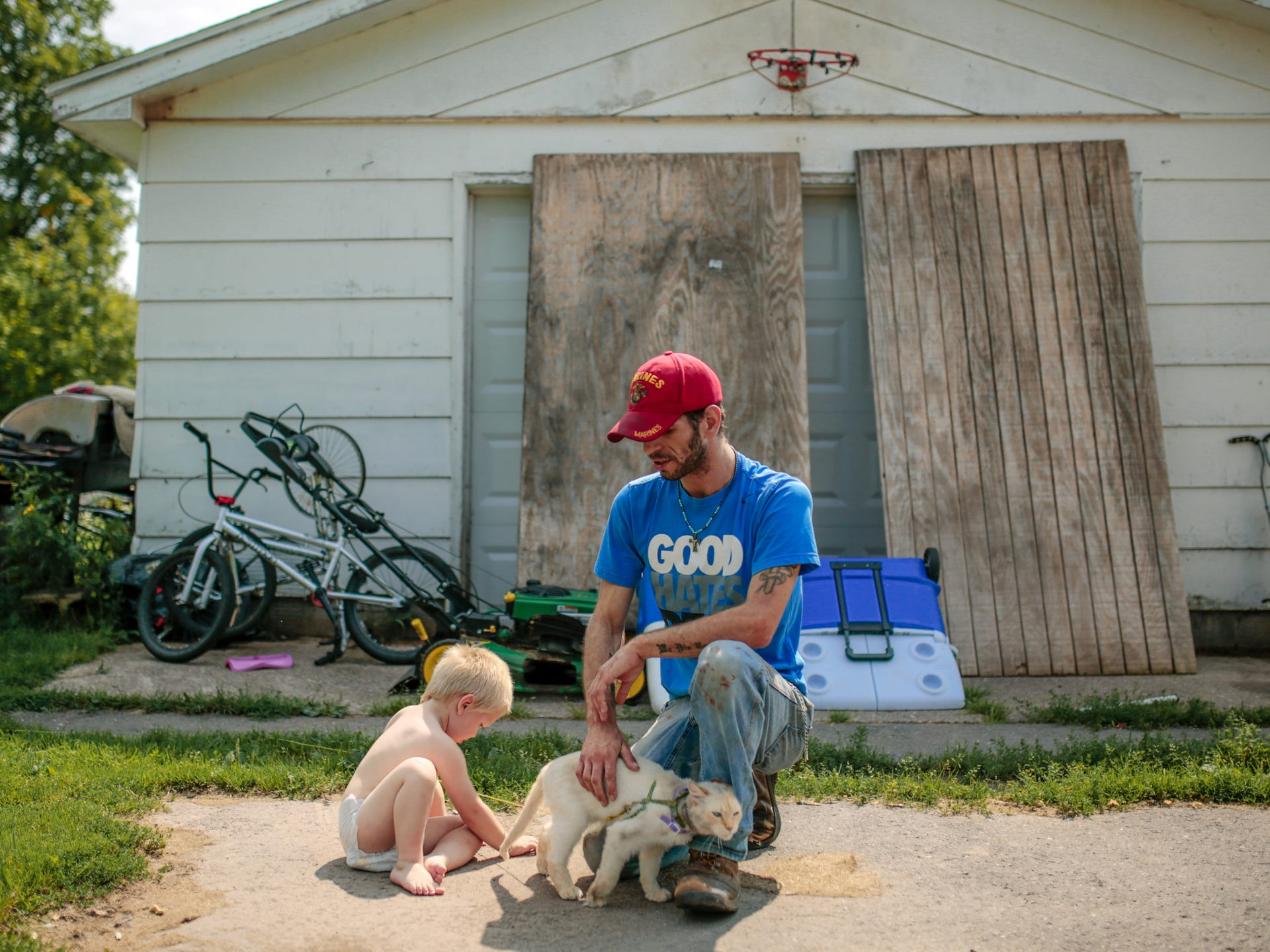 Tom Chobanian, 29, sits with his cat and his 2-year-old