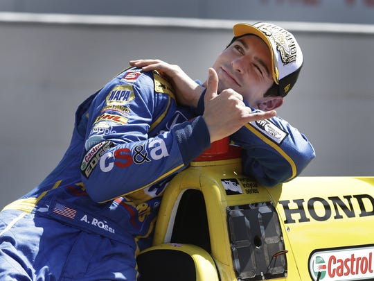 IndyCar driver Alexander Rossi (98) poses for photos