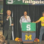 Dr. Fred Bonine, left, master of ceremonies Steve Garagiola, center, and Dr. Brian Petersburg fire up the crowd at recent VINA Tailgate Party. All will return for this year's event.