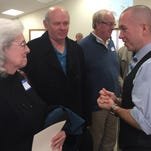 Richmond Mayor Dave Snow, left, talks with Carol Judy Saturday at the Wayne County Historical Museum, where alumni of Wayne County's past and present high schools gathered to reminisce about high school basketball.