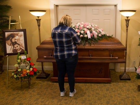 A guest at Aleah Beckerle's visitation service pays