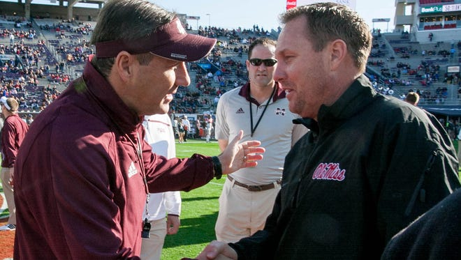 Dan Mullen, left, and Hugh Freeze rounded out their respective recruiting classes on Wednesday.