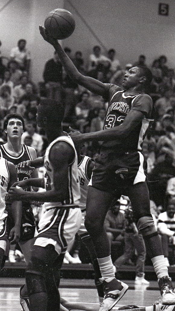 Riverside's Thomas Gray (32) puts up a shot against Greenville in the 1988 Class AAA Upper State championship game.